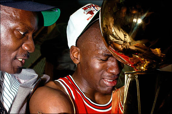 MJ's father James comforts MJ after winning his first NBA Title