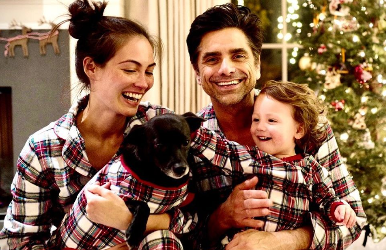 Caitlin McHugh with her husband and kid