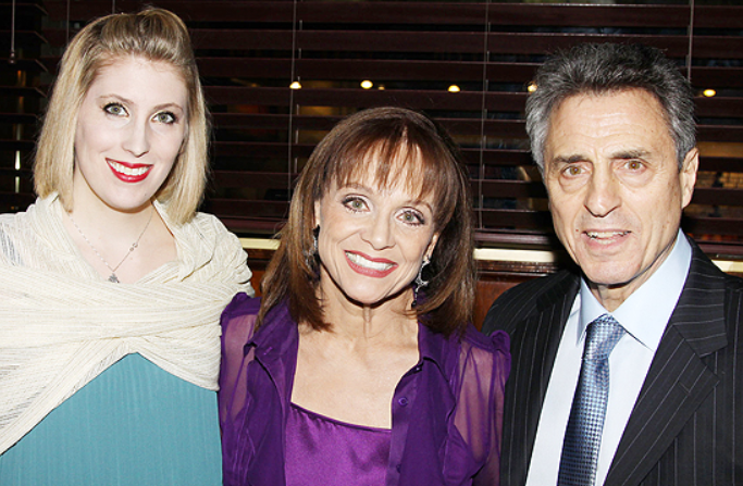 Cristina with her mother and father
