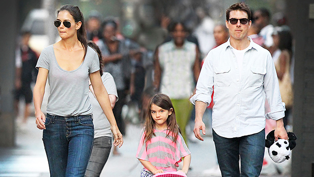 Suri Cruise with her parents