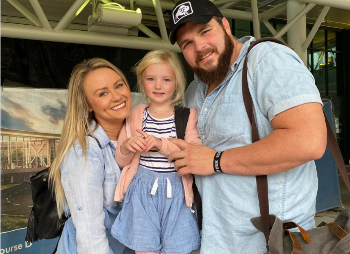 Jake Hoot with daughter and girlfriend