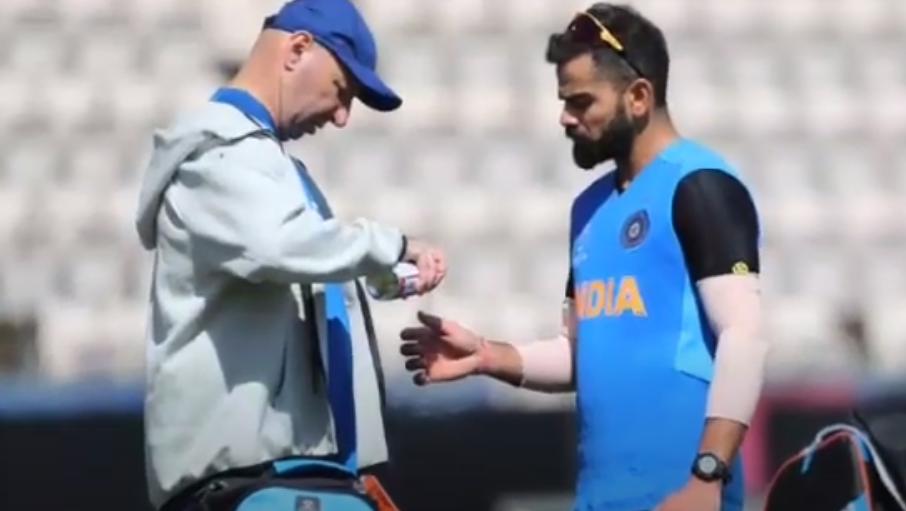 Patrick Farhart treating Virat Kohli